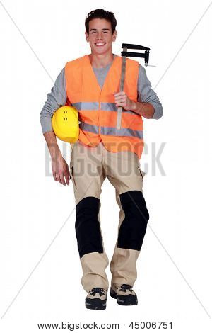 Worker with an F clamp