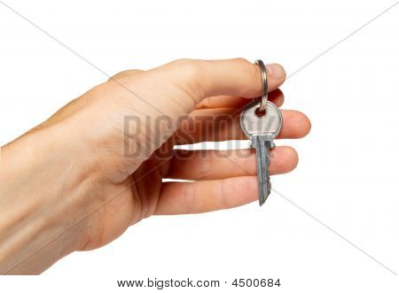 Silver Key In A Hand Isolated On White