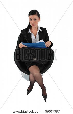 Businesswoman reviewing her files before a meeting