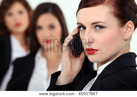 Pretentious woman talking on her mobile phone