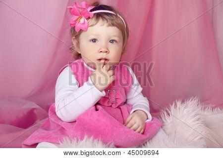 Portrait Of Funny Lovely Little Girl, Finger In Mouth