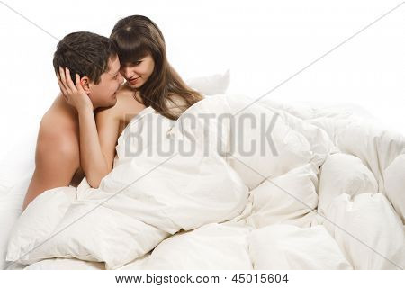 Couple of beauty lovers in bed on white background