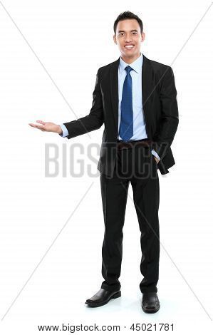 Smiling Asian Business Man Presenting A Blank Space