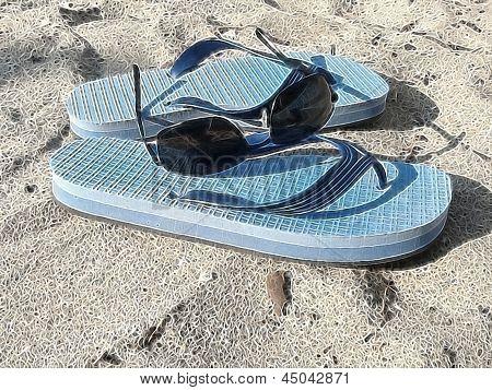 sunglasses and flip-flops on a sandy beach