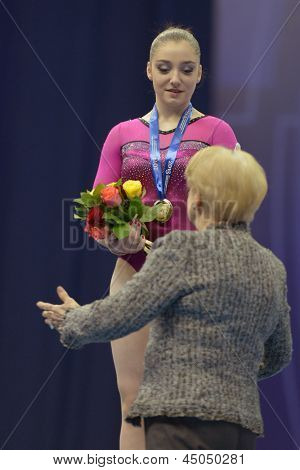 MOSCOW, RUSSIA - APRIL 20: Aliya Mustafina, Russia get gold medal on uneven bars in final of 5th European Championships in Artistic Gymnastics in Moscow, Russia on April 20, 2013 from Larisa Latynina