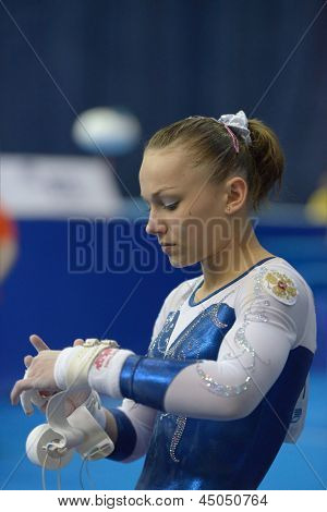 MOSCOW, RUSSIA - APRIL 20: Maria Paseka, Russia prepares for exercise on uneven bars in final of 5th European Championships in Artistic Gymnastics in Moscow, Russia on April 20, 2013