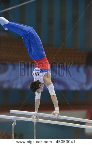 MOSCOW, RUSSIA - APRIL 21: Emin Garibov, Russia performs exercise on parallel bars in final of 5th European Championships in Artistic Gymnastics in Moscow, Russia on April 21, 2013