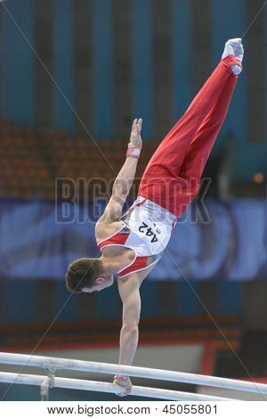 MOSCOW, RUSSIA - APRIL 21: Pascal Bucher, Switzerland performs exercise on parallel bars in final of 5th European Championships in Artistic Gymnastics in Moscow, Russia on April 21, 2013