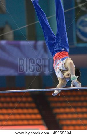 MOSCOW, RUSSIA - APRIL 21: Emin Garibov, Russia performs exercise on high bar in final of 5th European Championships in Artistic Gymnastics in Moscow, Russia on April 21, 2013
