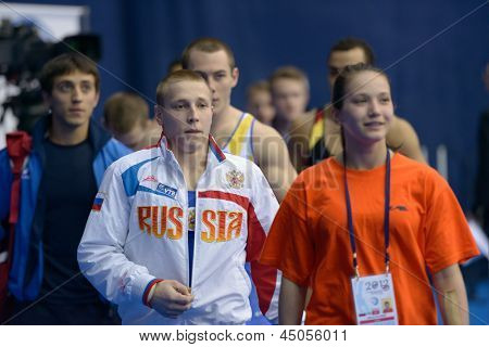 MOSCOW, RUSSIA - APRIL 21: Denis Ablyazin, Russia and other finalist in vault walks to the apparatus of 5th European Championships in Artistic Gymnastics in Moscow, Russia on April 21, 2013