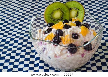 Delicious cup of self-made muesli with orange and berries