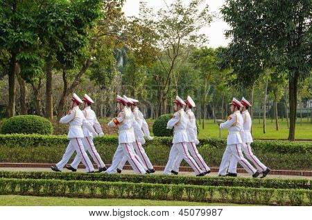 HANOI, VIETNAM - JANUARY 13: Vietnamese unidentified uniformed sentries march near the Ho Chi Minh mausoleum for the Changing the Guard Ceremony at tomb of Ho Chi Minh on January 13, 2013 in Hanoi.