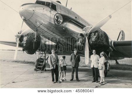 MOROCCO, CIRCA 1947 - Vintage photo of unidentified family in front of plane, Morocco, circa 1947
