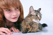 adorable child and cat looking at something with surprise poster