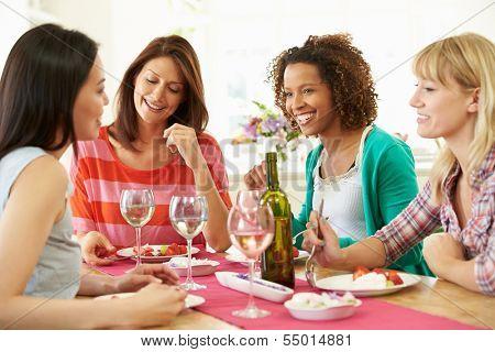 Group Of Women Sitting Around Table Eating Dessert