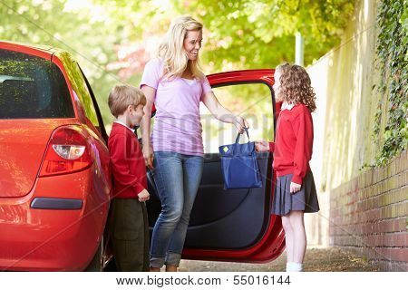 Mother Driving To School With Children