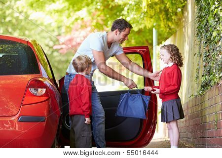 Father Driving To School With Children