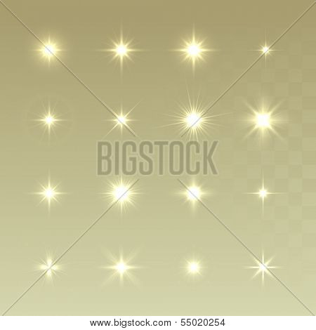 Set of Vector glowing light effect stars bursts with sparkles on golden background. Sparkling stars set. Christmas stars.
