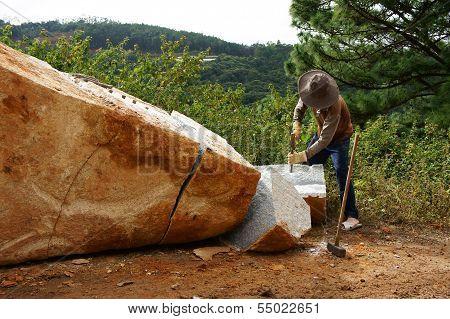 Worker Split Large Rock  For Road-works