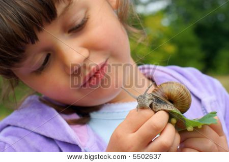 Girl And Garden Snail
