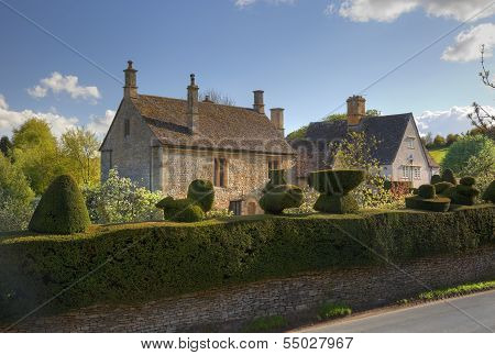 Cotswold House With Topiary Hedge