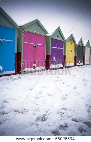 Beach huts in snow at Christmas