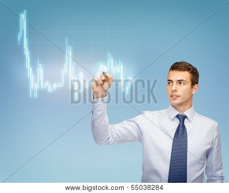 business, money and office concept - attractive buisnessman or teacher with marker drawing forex chart