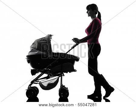 one caucasian woman prams baby walking silhouette on white background