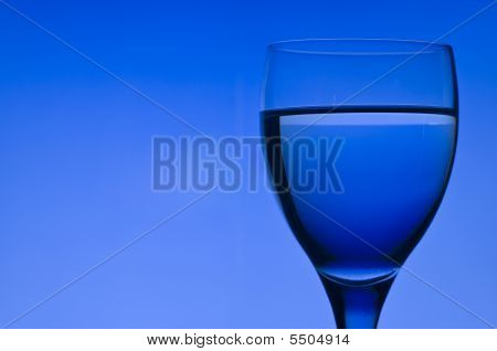 Blue Background With Crystal Glass