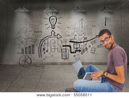 Composite image of man wearing glasses sitting on floor using laptop and looking at camera poster