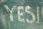 "The word ""yes"" written on a blackboard with chalk. poster"