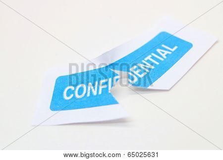 Confidentiality ripped representing a data breach or violation of trust. poster