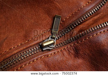 Zipper of a brown leather jacket
