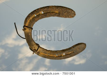 horseshoe falling down from the sky freely poster