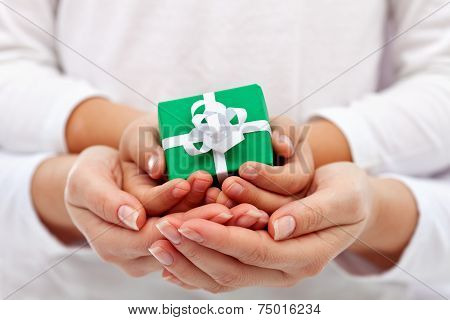 Giving A Present - Child And Woman Hands With Gift Box