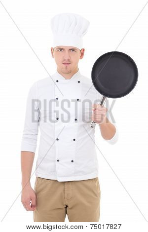 Young Handsome Man Chef In Uniform With Teflon Frying Pan Isolated On White