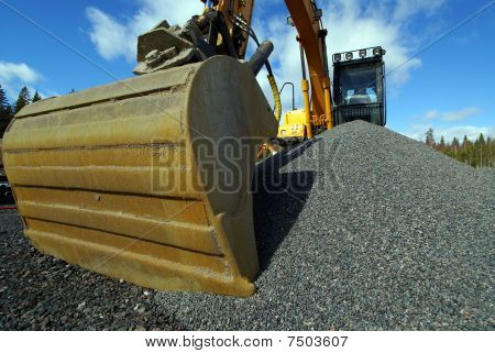Excavator And Construction Machinery At A Construction Site Outdoors