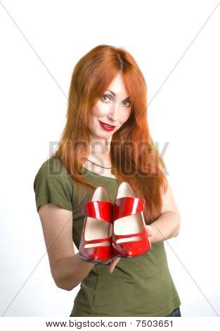 Woman With The Elegant Red Varnished Shoes
