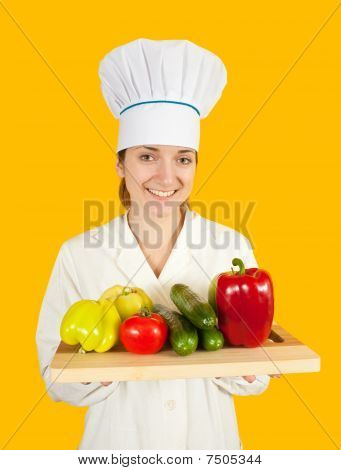 Female Cook With  Vegetables