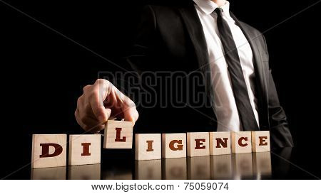 Wooden Pieces With Diligence Text On Black Background