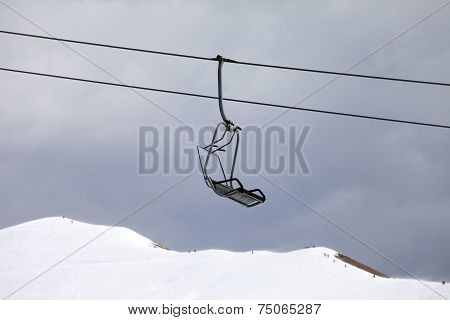 Chair Lift And Off-piste Slope At Gray Day