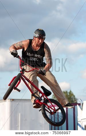 Man Spins His Bike In Midair Performing At Bmx Show