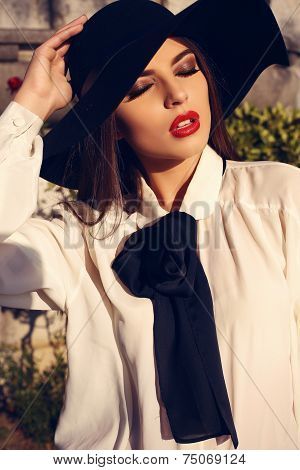 Portrait Of Beautiful Ladylike Woman In Elegant Blouse And Hat
