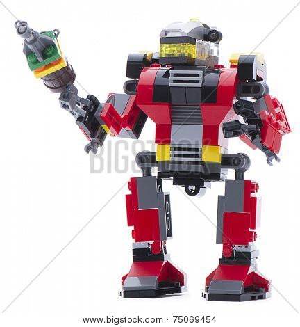 Ankara, Turkey - November 23, 2013: Lego Creator rescue robot with an armored chrome head protection, pose able arms and legs, rocket boosters and antenna isolated on white background.