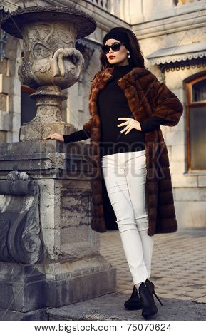 Beautiful Brunette Woman In Luxurious Fur Coat And Sunglasses