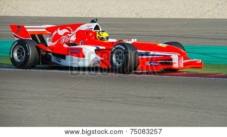 ASSEN, NETHERLANDS - OCTOBER 19, 2014: Nigel Melker, driver of the Dutch Formula A1 team, goes wide over the curbs during the first race.