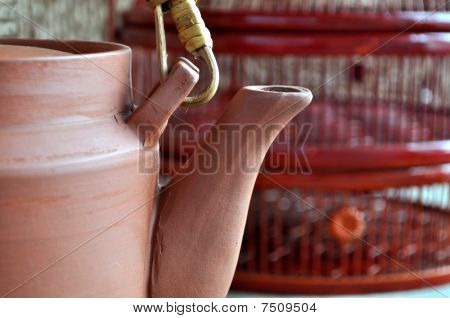 Clay teapot in front of bamboo basket
