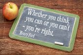 Whether you think you can or you can't - you're right, motivational quote by Henry Ford on a slate blackboard against red barn wood poster