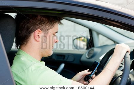 Concentrated Man Sending A Text Sitting In His Car