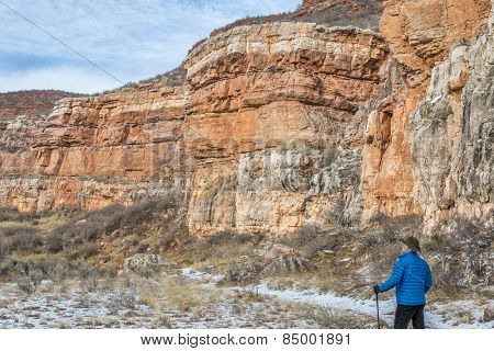 senior male hiking in sandstone canyon in winter, Red Mountain Open Space near Fort Collins, Colorado